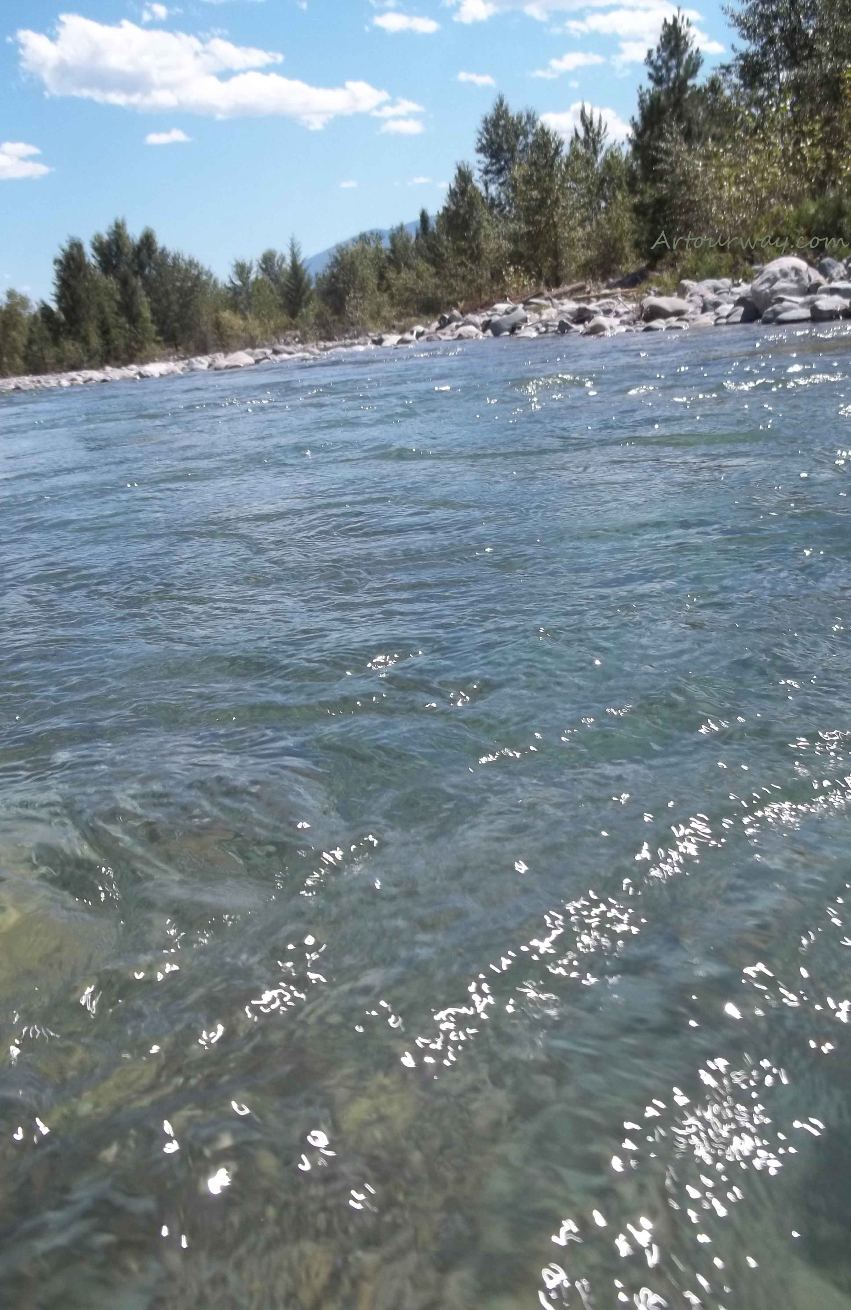Wildhorse rushes . . rumbling and rippling along the way. Kootenay River Valley, located in Eastern British Columbia.